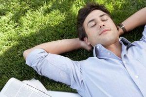 Man grounding on grass