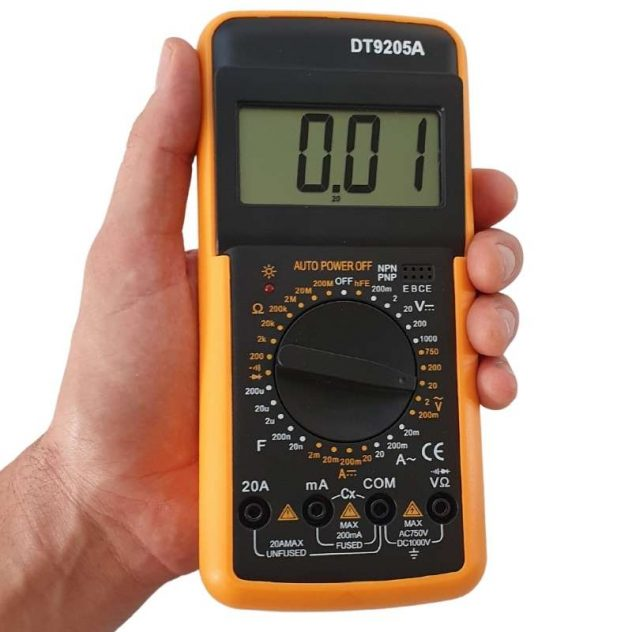 Earthing mat tester being held in hand.